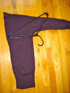 2) Place hanger under the arm as pictured