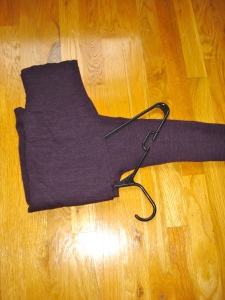 3) Fold bottom half of sweater over the hanger