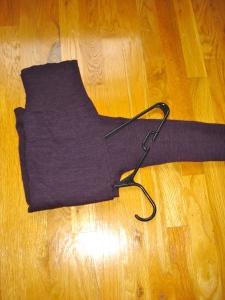 3) Fold bottom half of sweater over the hanger